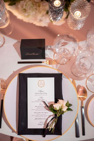 wedding reception classic modern place setting white black gold menu and flatware fresh flower sprig