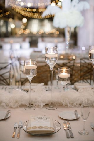 A Charming Fete Floating Candles on Table neutral wedding reception