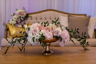 wedding-reception-springtime-decor-lounge-gold-table-purple-flowers-pillows-centerpiece-greenery
