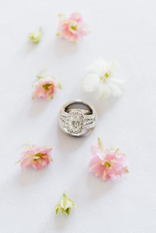engagement-ring-oval-diamond-halo-with-diamond-band-inside-mens-groom-ring-pink-white-flowers