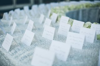 sequined-linens-topped-with-simple-seating-card