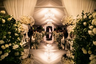 wedding ceremony mirror aisle chandelier white flowers candles geller events the hidden garden