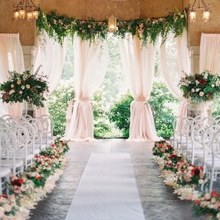 A Charming Fete Romantic Ceremony colorful flowers drapery
