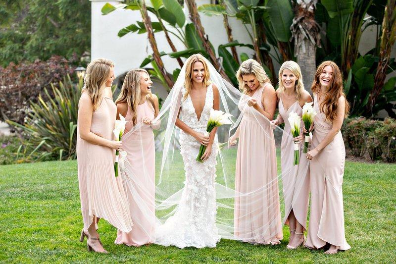 Bridesmaids Holding Bride's Veil