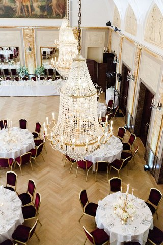 wedding-reception-in-germany-hotel-grand-chandelier-crystal-gold-details-aerial-view-of-reception