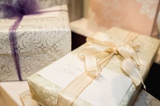 wedding-gift-presents-registry-with-bows-and-cards-from-friends-and-family