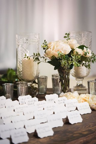 wedding-escort-cards-calligraphy-lehr-and-black-silver-candle-votives-white-rose-on-wood-table