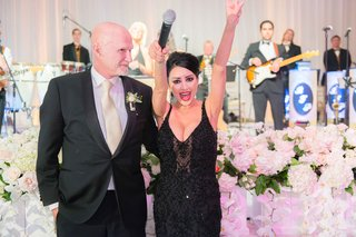 bride-in-black-beaded-designer-gown-with-microphone-at-wedding-reception-live-band