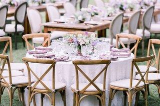 wedding-reception-outdoor-hawaii-venue-light-purple-linen-wood-vineyard-chair-low-flower-arrangement