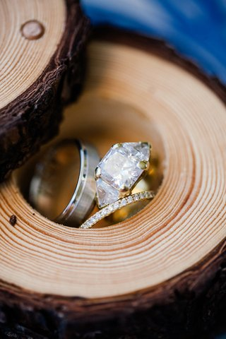 yellow-gold-diamond-engagement-ring-with-three-stones-diamond-wedding-band-and-grooms-band