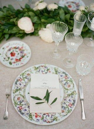 wedding-reception-beige-linen-silver-flatware-crystal-glassware-garland-sprig-of-greenery