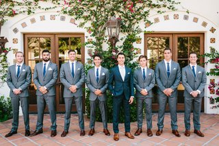 wedding-portrait-groom-and-groomsmen-in-grey-suits-with-navy-blue-ties-brown-dress-shoes-spanish