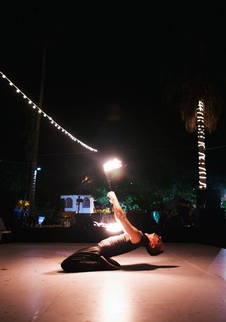 destination-wedding-ideas-fire-dancer-mexico-wedding-on-dance-floor-fire-baton-twirling