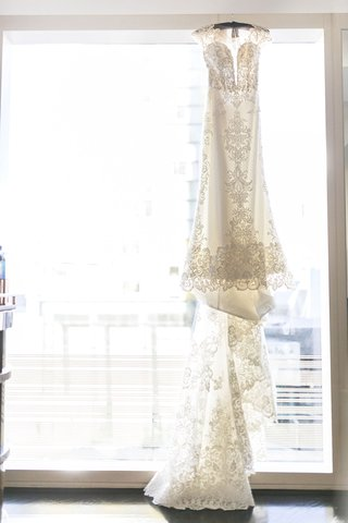 cristiano-lucci-wedding-dress-with-lace-details-cap-sleeves-and-long-train