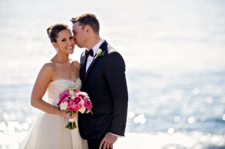 groom-kisses-brides-cheek-in-front-of-ocean-at-terranea-resort