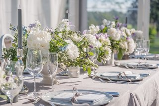 grey-linens-white-flowers-with-some-blue-and-lavender-fake-grey-tapered-candles
