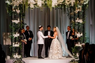 wedding-ceremony-chuppah-four-post-candles-greenery-white-flowers-contrasting-palette-natural-decor