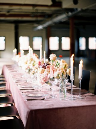 wedding-reception-pink-velvet-linens-with-tall-candleholders-taper-candles-velvety-clear-plates