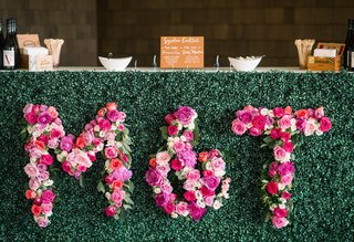 wedding-bar-with-initials-made-with-bright-pink-flowers