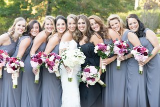 watters-bridesmaid-dresses-bride-in-off-shoulder-anne-barge-wedding-dress-maid-of-honor-in-different