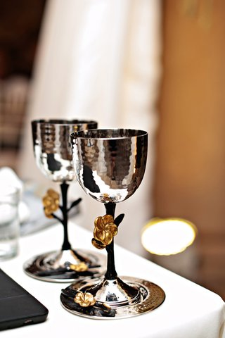 a-silver-kiddush-cup-set-with-black-stem-and-gold-flowers