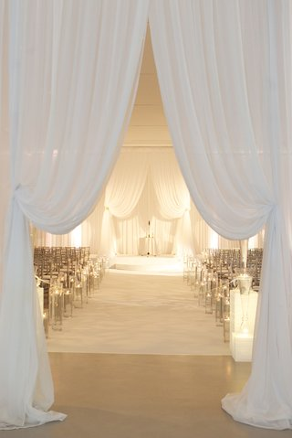all-white-wedding-ceremony-with-chiffon-drapery-and-candles