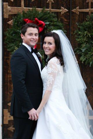bride-in-oscar-de-la-renta-wedding-dress-with-groom-in-tuxedo-and-bow-tie