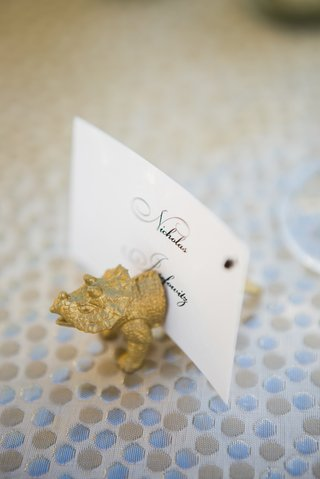 small-gold-figurine-of-triceratops-dinosaur-to-hold-place-card