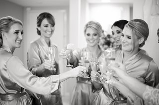black-and-white-photo-of-women-holding-champagne