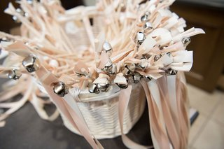wedding-ceremony-favors-for-guests-pink-ribbon-silver-bells-for-guests-to-wave-after-ceremony