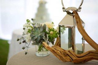 driftwood-reception-table-decor-foliage-anemone-white-green-lantern-flowers