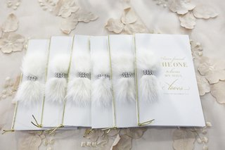 wedding-ceremony-programs-with-gold-cord-feathers-and-crystal