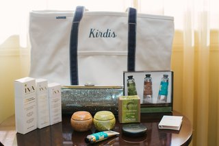 embroidered-tote-bag-with-beauty-products-and-crystal-clutch