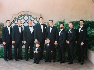 groom-with-groomsmen-tuxedo-with-pocket-square-bow-tie-and-two-ring-bearer-in-matching-outfits