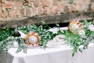 wedding-reception-with-italian-rusus-eucalyptus-and-king-protea-blooms