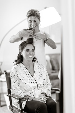 black-and-white-photo-bride-getting-hair-done-ready-before-wedding-morning-of