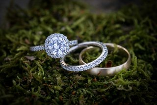 diamond-engagement-ring-bands-gold-moss-outdoors-wedding-bride-groom