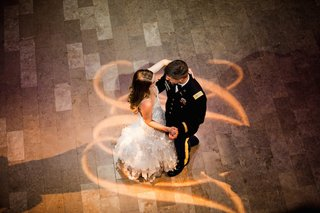 aerial-view-of-military-wedding-couple-sharing-first-dance