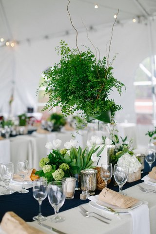 nautical-theme-wedding-reception-with-greenery-centerpiece-and-low-white-tulip-flower-arrangements