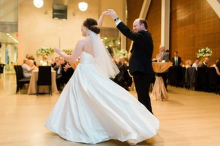 bride-in-justin-alexander-plain-ball-gown-spun-by-groom-in-menguin-suit-during-first-dance