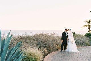 bride-in-alfred-angelo-wedding-dress-groom-in-tuxedo-at-terranea-wedding-venue-in-california