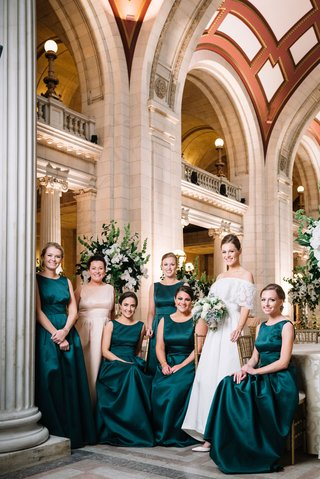 bride-in-mothers-wedding-dress-with-bridesmaids-in-high-neck-emerald-gowns-christmas-new-year