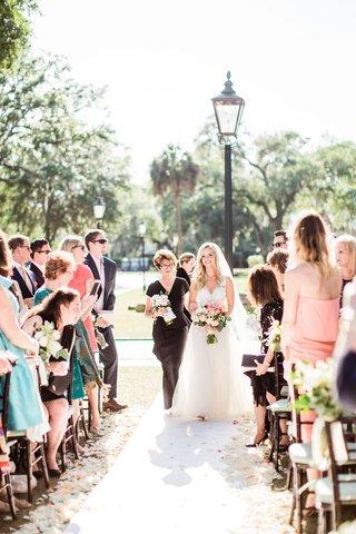 bride-in-mark-ingram-wedding-dress-outdoor-south-carolina-wedding-mother-of-bride-walking-down-aisle
