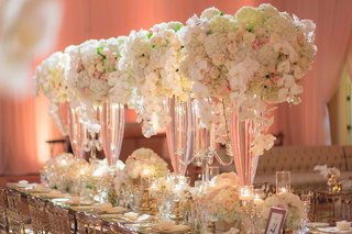 tall-wedding-reception-centerpieces-with-orchids-hydrangeas-roses-on-table-with-clear-chairs