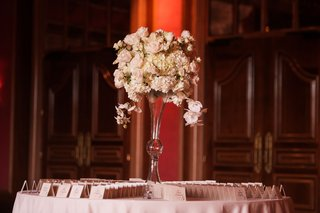 wedding-reception-round-table-escort-cardss-ivory-rose-hydrangea-and-orchid-flowers