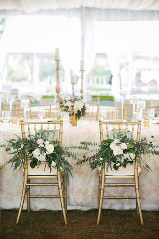 chiavari-chairs-with-flowers-and-baby-blue-eucalyptus-marking-bride-and-groom-chairs
