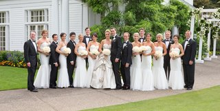 bride-and-groom-with-tuxedo-groomsmen-and-white-dresses