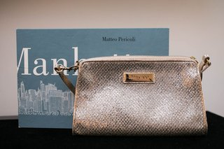 brides-jimmy-choo-wedding-clutch-bag-on-table