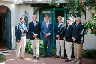 groom-groomsmen-blue-white-jackets-suits-broken-arm-light-pants-oceanside-california-beach-wedding