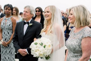 wedding-ceremony-taylour-rutledge-with-mom-and-dad-shane-vereen-mom-in-background-outdoor-ceremony